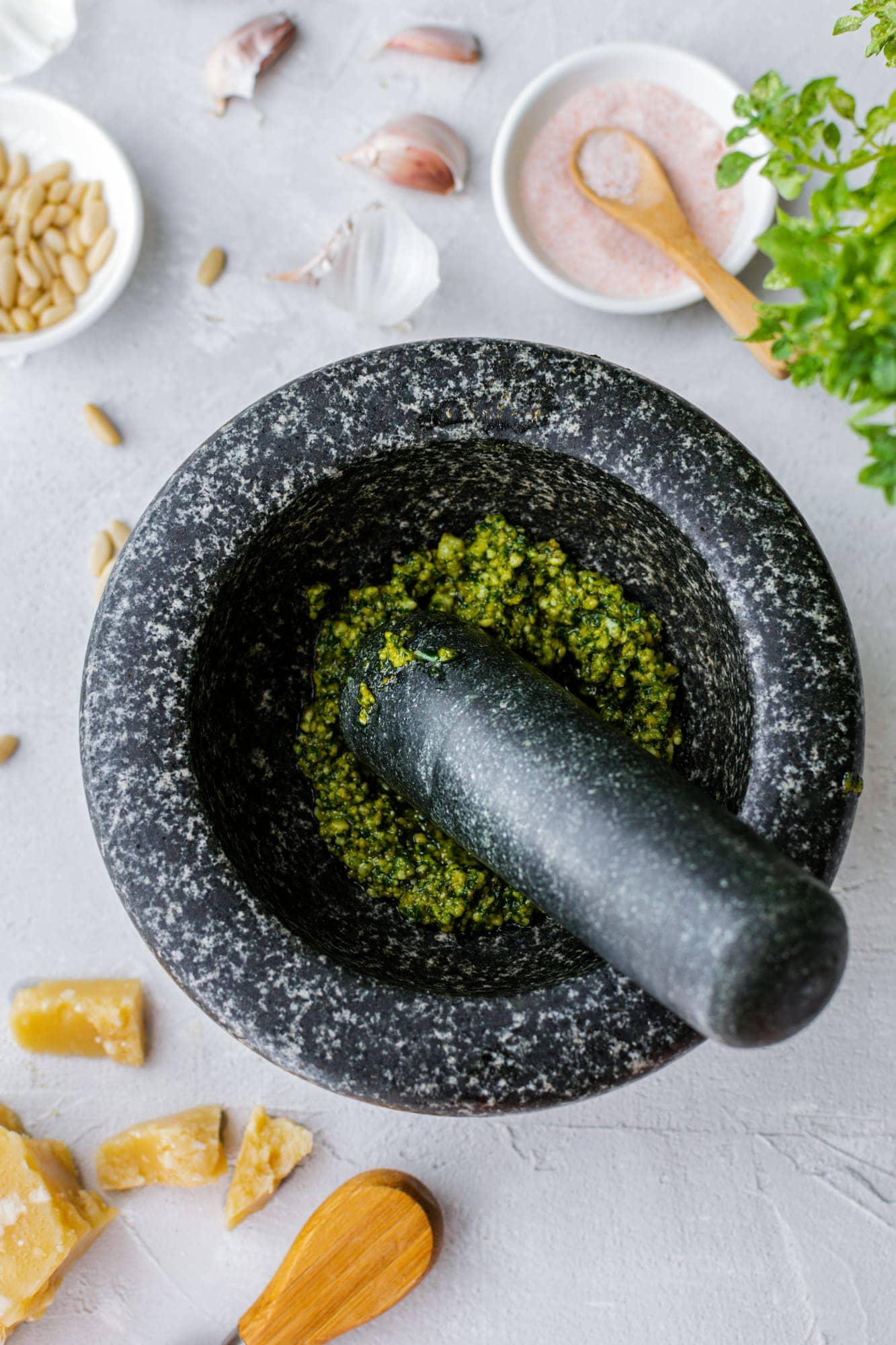 Process of preparation traditional italian pesto genovese sauce with mortar and pestle