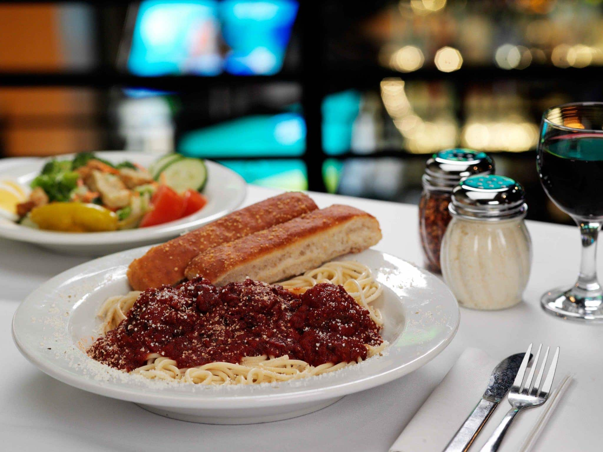 Homemade Italian spaghetti sauce goes well with red wine.