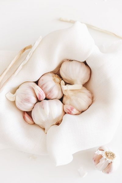 cloves of garlic in basket