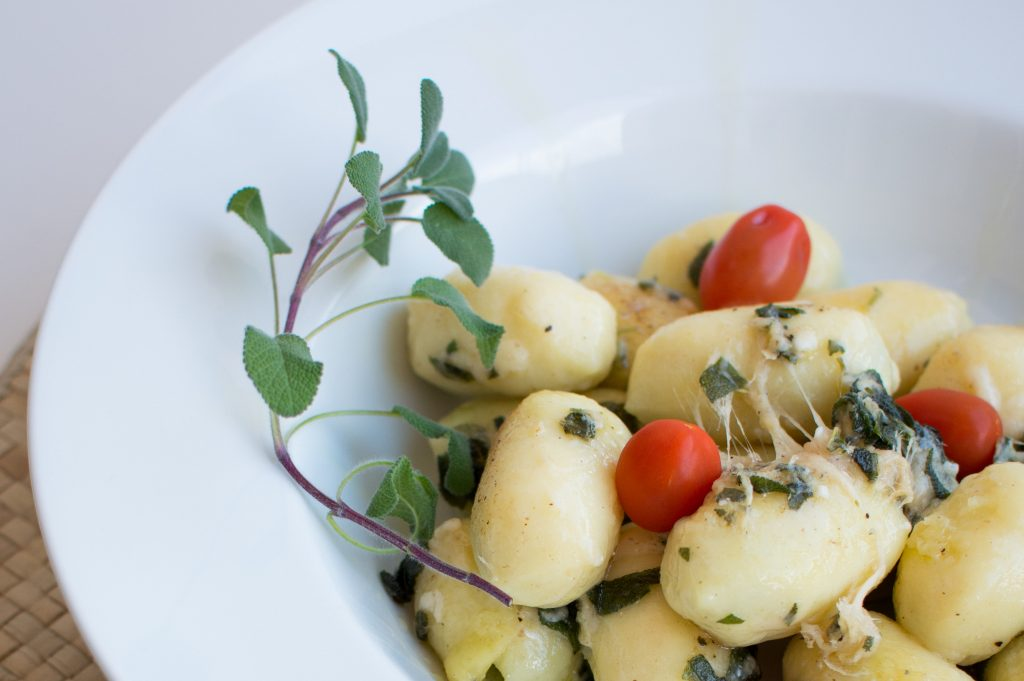 make gnocchi with butter, sage, and tomatoes
