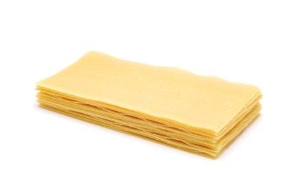 raw lasagna pasta on white